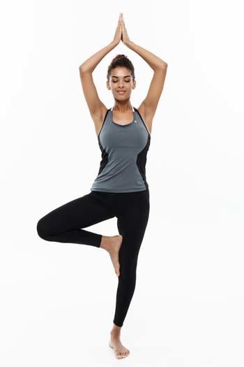 An image of a woman doing yoga and meditation