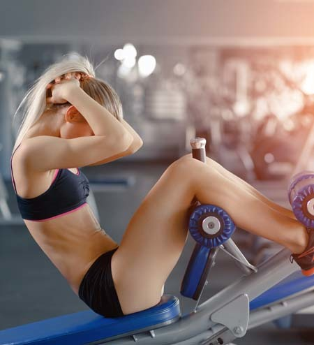 An image of a woman doing abs workout