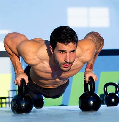 An image of an athlete doing push ups