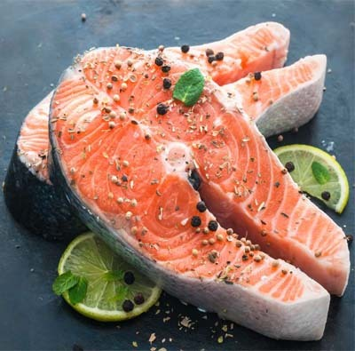 An image of fish meat with lemon
