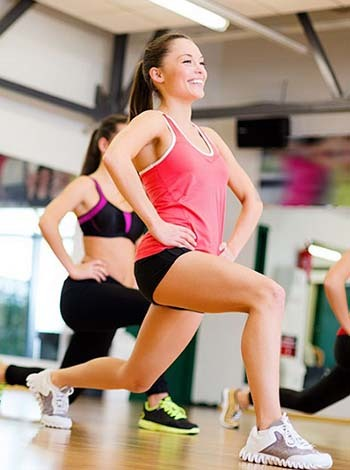 An image of girls doing aerobics in gym
