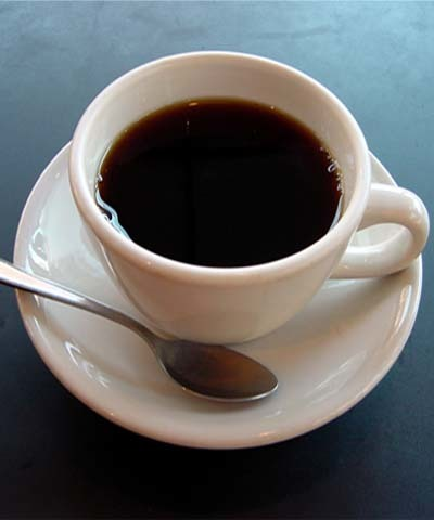 An image of  a cup filled with black coffee