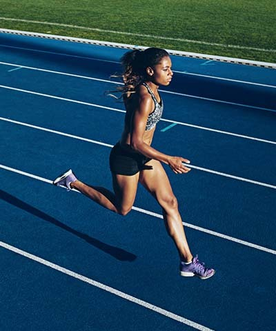 An image of an athlete woman running in the racing track